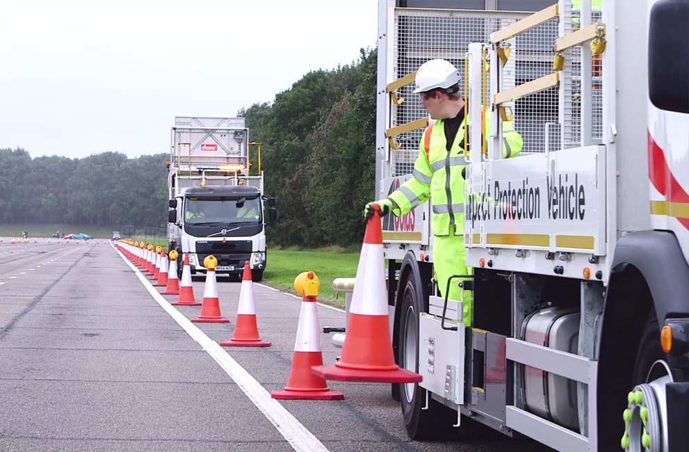 Colas Ltd AutoIPV vehicles and an Operative Laying cones on the road