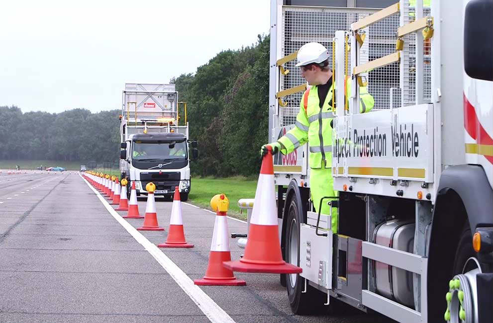 Colas autonomous IPV vehicles and operative setting up cones on the road