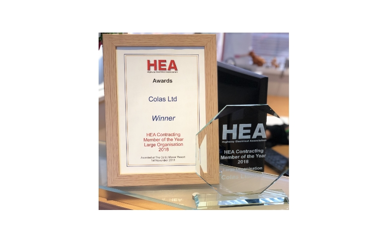 Highway Electrical Association logo award certificate in wooden frame and a glass award